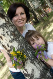 Happy mum and her small daughter Stock Photos