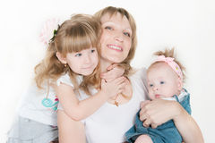 Happy mum with two daughters Stock Images