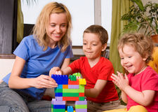 Happy Mum With Children Plays Cubes Stock Photography