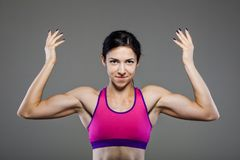Happy muscular fitness girl Stock Photos