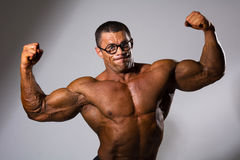 Happy muscular man with a naked torso Royalty Free Stock Image