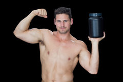 Happy muscular man posing with nutritional supplement Stock Images