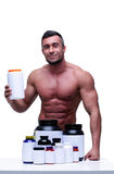 Happy muscular man with sports nutrtion Stock Photos