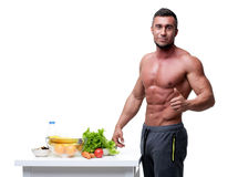 Happy muscular man standing with thumbs up Royalty Free Stock Photography