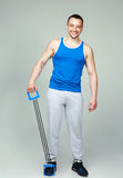 Happy muscular sportsman with expanders Royalty Free Stock Photography