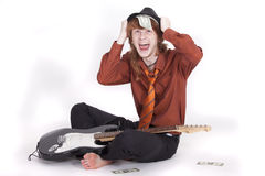 Happy musician with dollars Stock Images