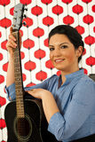 Happy musician woman with guitar Royalty Free Stock Photos