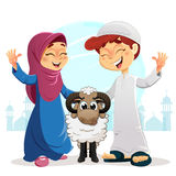 Happy Muslim Boy and Girl with Sheep Stock Photos