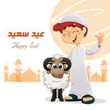 Happy Muslim Boy with Sheep. Happy Feast Written in Arabic, Traditional Eid Concept Royalty Free Stock Photography