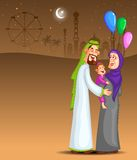 Happy muslim family celebrating Ramadan Kareem Stock Photos