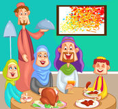 Happy muslim family enjoying dinner Stock Photo