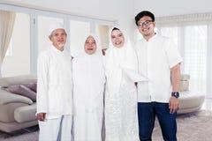 Happy muslim family portrait in living room