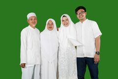 Happy muslim family portrait in studio