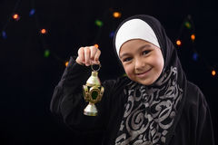 Happy Muslim Girl Celebrating with Ramadan Lantern Royalty Free Stock Photography