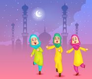 Happy muslim girls wishing Eid mubarak Stock Photo
