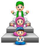 Happy Muslim kid cartoon waving hand sitting on the stair stock illustration