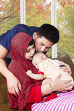 Happy muslim parents kiss their child Royalty Free Stock Photo