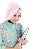 Happy muslim student portrait holding a few books Stock Image