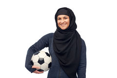 Happy muslim woman in hijab with football Stock Photos