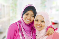 Happy Muslim women. Standing inside house royalty free stock image