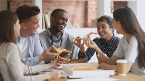Happy mutiethnic young students people having fun share pizza