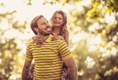 Happy with my daddy. Little girl. Stock Photography