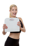 Happy with my weight. Happy fitness woman holding scales Stock Images