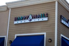 Happy Nails and Spa store sign royalty free stock photos