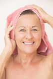 Happy naked mature woman with towel Royalty Free Stock Images