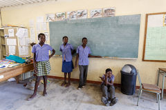 Happy Namibian school children waiting for a lesson. Royalty Free Stock Images
