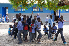 Happy Namibian school children waiting for a lesson. Stock Photo