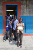 Happy Namibian school children waiting for a lesson. Royalty Free Stock Image