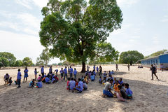 Happy Namibian school children waiting for a lesson. Stock Images