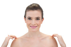 Happy natural brown haired model touching her shoulders Royalty Free Stock Image
