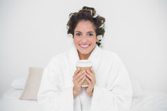 Happy natural brunette holding disposable cup Royalty Free Stock Images