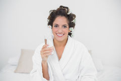Happy natural brunette holding glass of water Stock Photos