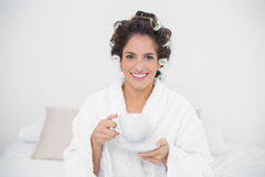 Happy natural brunette holding a mug Stock Photos