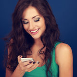 Happy natural emotion woman texting the sms on mobile phone on b Royalty Free Stock Photos