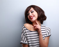Happy natural laughing young short hairstyle woman in fashion bl. Ouse on blue background Royalty Free Stock Photos