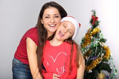 Happy natural smiling mother embrace her cute daughter stock photo