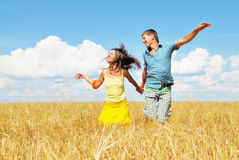 Happy with nature. Happy young people running on rural background Stock Image
