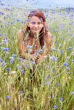 Happy in nature. Beautiful young woman enjoying the nature Royalty Free Stock Photography