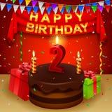 Happy 2nd Birthday with chocolate cream cake and triangular flag Stock Images
