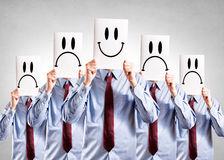 Happy and negative faces Stock Photo