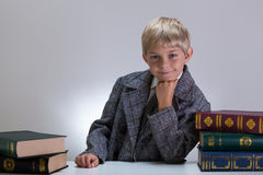 Happy nerd among books Royalty Free Stock Photography