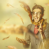 Happy nerd celebrating the fall of autumn Royalty Free Stock Image