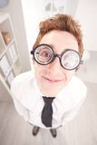 Happy nerd clerk with big glasses Stock Photo