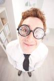 Happy nerd clerk with big glasses Stock Photo