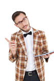 Happy nerd holding tablet pc and pointing Royalty Free Stock Photography