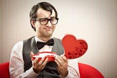 Happy nerd man open chocolate box love gift.  Stock Photos